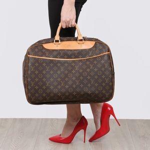 Authentic Alize 24 2 way travel bag Louis Vuitton